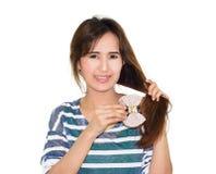 Woman with hair clip Stock Photos