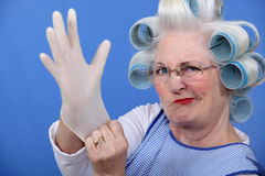 Woman with hair curlers. Senior woman with hair curlers stock photography