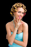 Woman with hair curlers Stock Images