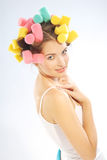 Woman in hair curlers Stock Photo