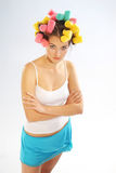 Woman in hair curlers Stock Images