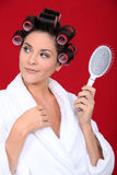 Woman with hair curlers Stock Image