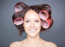 Woman with hair curlers Royalty Free Stock Photography