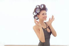 Woman in hair curlers indoors Royalty Free Stock Images