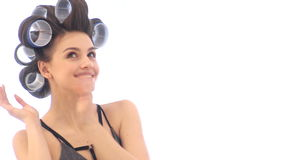 Woman in hair curlers indoors stock footage