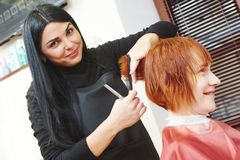 Woman hair cutting work royalty free stock photo