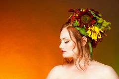 A woman with hair decorated with flowers. Stock Photography
