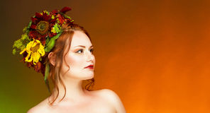 A woman with hair decorated with flowers. Royalty Free Stock Photos