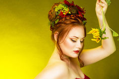 A woman with hair decorated with flowers. Stock Photo