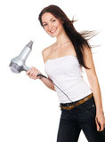 Woman with a hair dryer. White background stock photo