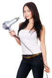 Woman with a hair dryer Royalty Free Stock Image