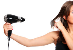 Woman and a hair dryer Stock Image