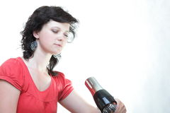 Woman with a hair dryer isolated Stock Image