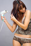 Woman with hair dryer Royalty Free Stock Image