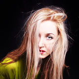 Woman with hair fluttering in wind Royalty Free Stock Photography