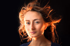 Woman with hair flying Stock Images