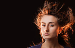 Woman with hair flying Stock Photos