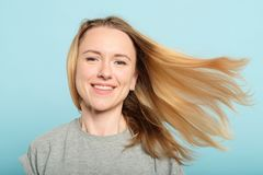 Woman hair flying wind haircare products beauty stock photo