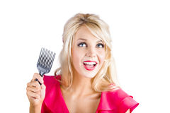 Woman with hair pinup brush Stock Photo