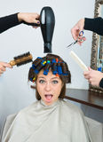 Woman with hair rollers. Happy woman with hair rollers in her hair having treatment Royalty Free Stock Images