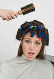Woman with hair rollers. In her hair Stock Photo