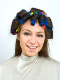 Woman with hair rollers. Happy woman with hair rollers in her hair Royalty Free Stock Photo