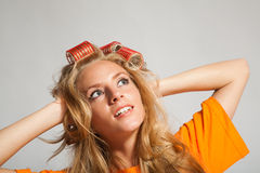 Woman with hair-rollers. Young beauty woman with hair-rollers Stock Image