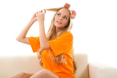 Woman with hair-rollers. Young beauty woman with hair-rollers Royalty Free Stock Images