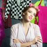 Woman with hair-rollers Stock Photography