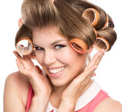 Woman in hair rollers Royalty Free Stock Photography