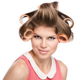 Woman in hair rollers Stock Photos