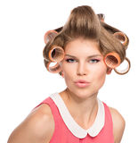 Woman in hair rollers Royalty Free Stock Images