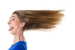 Woman hair ruffled by wind. Woman - isolated on white - hair ruffled by the wind stock photo