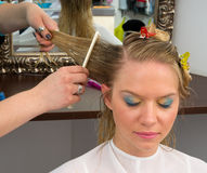 Woman in hair salon Stock Images