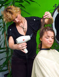 Woman in hair salon Stock Photos