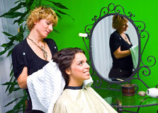 Woman in hair salon Stock Photography