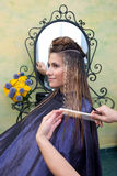 Woman in hair salon Stock Image