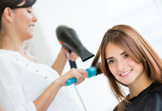 Woman at the hair salon Stock Photography