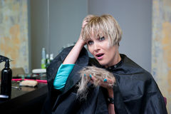 Woman in hair salon with cutted hair Royalty Free Stock Photo