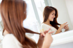 Woman at the hair salon Stock Images