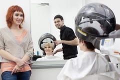 Woman at hair saloon Royalty Free Stock Photos