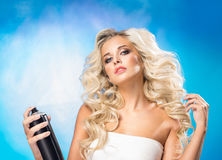 Woman with a hair spray Royalty Free Stock Images