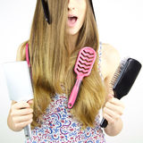 Woman with hair stock in brushes hairstyle Stock Image