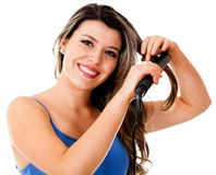 Woman with a hair streighterner Royalty Free Stock Photography