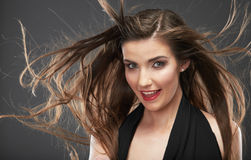 Woman hair style fashion portrait . Wind in hair. Royalty Free Stock Photography