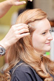 Woman hair styling royalty free stock photo