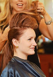 Woman hair teasing Stock Photo