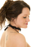 Woman with hair up from side eyes down bare shoulder close Stock Photo