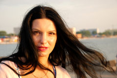 Woman with hair in wind at sea royalty free stock photography