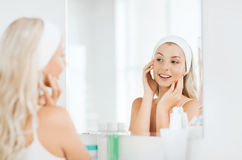 Woman in hairband touching her face at bathroom Royalty Free Stock Photo